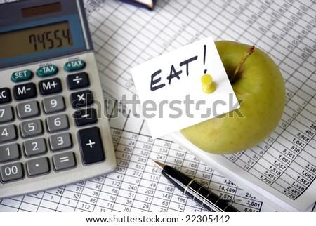 eat reminder on office desk - stock photo