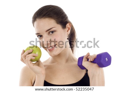 Eat Right & Exercise Concept: Healthy young woman holding a green apple and dumbbell isolated over white background