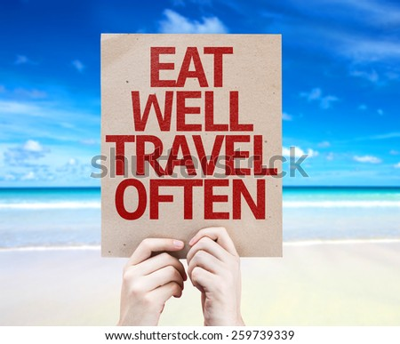 Eat Well Travel Often card with beach background - stock photo