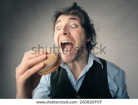 Eating a hamburger - stock photo