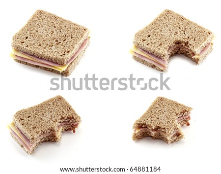 eating a sandwich of cheese and ham - stock photo