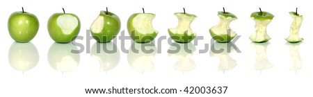 eating a tasty green apple isolated on white