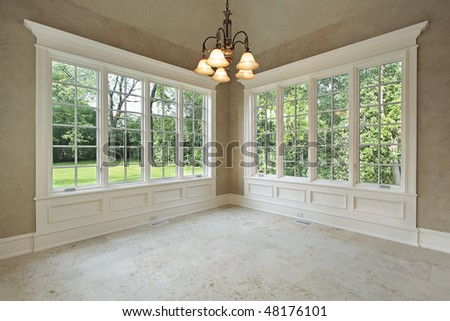 Eating area in luxury home with back yard view