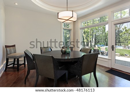 Eating area in luxury home with pool view - stock photo