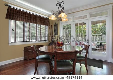 Eating area of luxury home with porch view