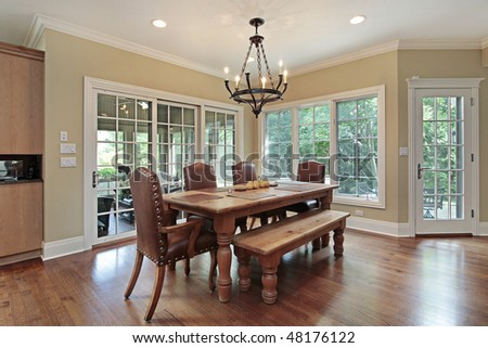 Eating area of upscale home with porch view - stock photo