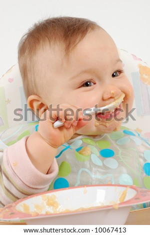 eating baby girl - stock photo