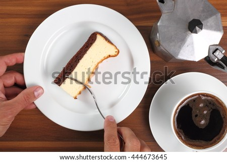 Eating Cheesecake and coffee cup. Directly Above. - stock photo