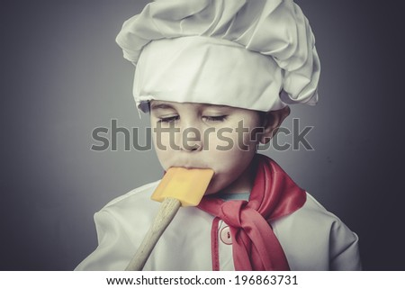 eating child dress funny chef, cooking utensils - stock photo