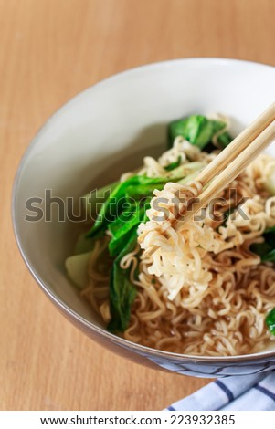 eating chinese noodles - stock photo