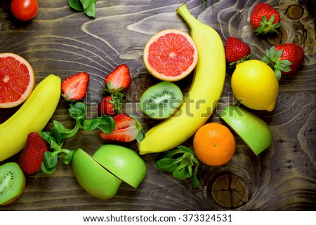 Eating healthy food - healthy diet with fresh organic fruits - stock photo