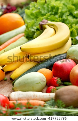 Eating healthy food - organic food (fruits and vegetables) - stock photo