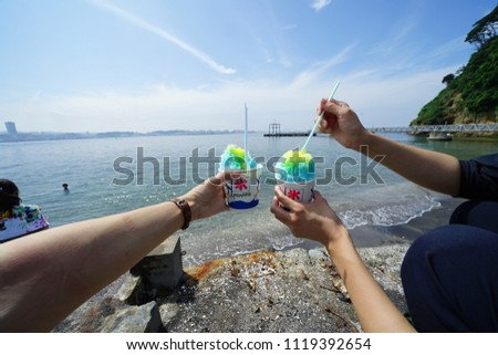 https://thumb7.shutterstock.com/display_pic_with_logo/167494286/1119392654/stock-photo-eating-ice-by-the-sea-1119392654.jpg