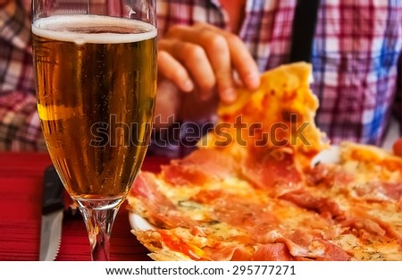 Eating pizza with hands - stock photo