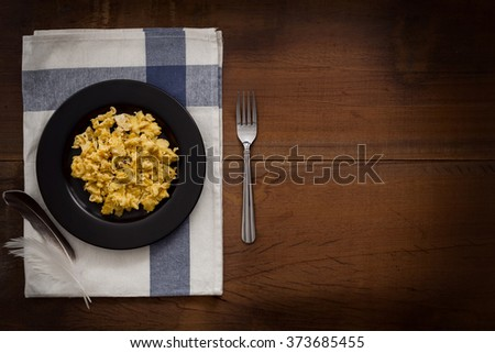 eating scrambled eggs flat lay still life rustic with food stylish raw ingredient poultry healthy cholesterol protein vitamin natural rustic low key - stock photo