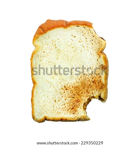 Eating slices of crusty bread on a white background - stock photo
