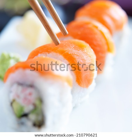 eating sushi with chopsticks