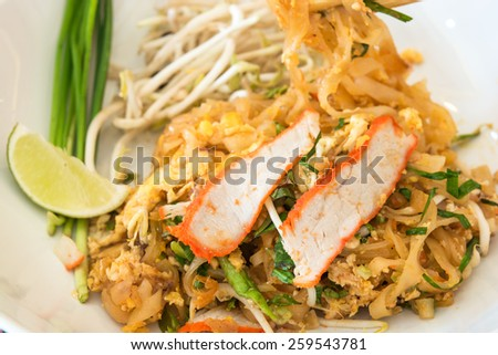 Eating time whit Pad thai, Thai food ,focus on roasted red pork - stock photo