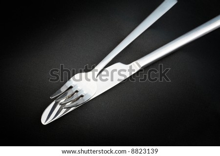 White Background Manicure Tools On A Black Hunting Knife