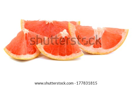 Eating with sweet grapefruit slices - stock photo