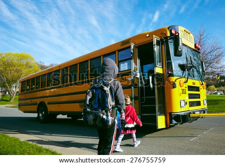 EAU CLAIRE, USA â?? April 29, 2015. American children getting on the schoolbus