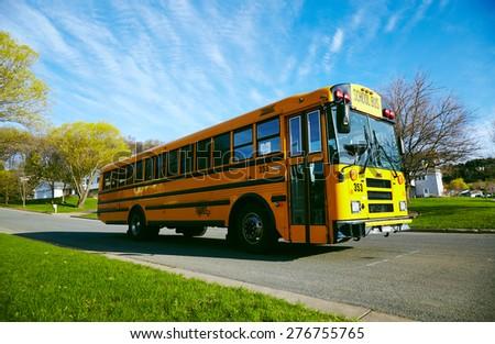 EAU CLAIRE, USA â?? April 29, 2015. School bus on road  - stock photo