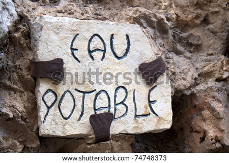 EAU POTABLE - Stone sign for clean water (in french), in the old village of Saint Paul de Vence, south of France