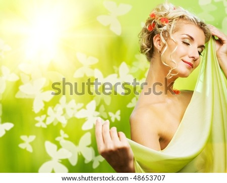 eautiful young woman with fresh flowers in her hair. Spring concept. - stock photo