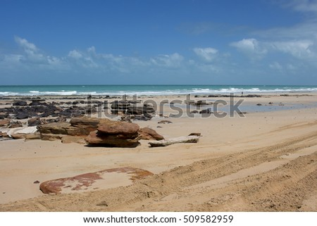 Ebb tide rocky shore  Cable Beach, Broome , Western Australia, a 22 kilometre-long stretch of pure white sand, set against red ochre cliffs and fringed by the turquoise waters of the Indian Ocean