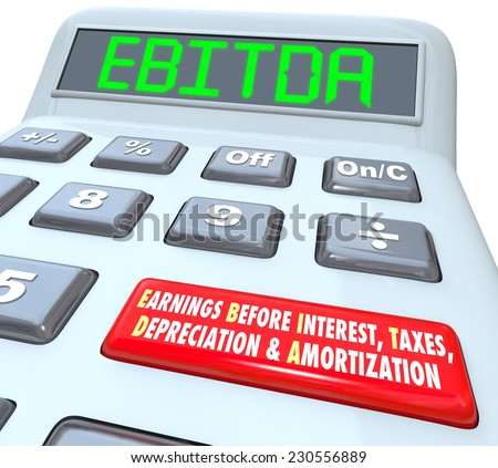 EBITDA word in digital letters on a calculator display to illustrate earnings before interest, taxes, depreciation and amortization - stock photo