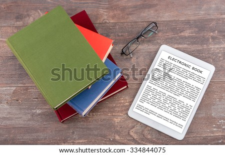Ebook and books, top view (lorem ipsum text used) - stock photo