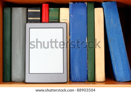 Ebook and old books on bookshelf - stock photo