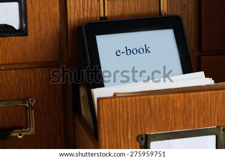Ebook Reader in a Library  - New Technology Concept - stock photo