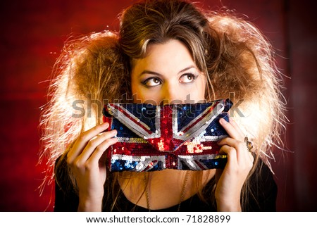 Eccentric British woman holding a purse with the Union Flag