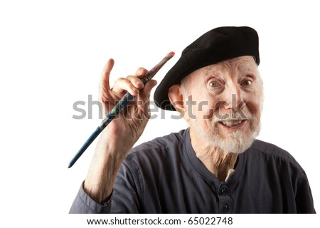 Eccentric senior artist with brushes wearing a beret - stock photo