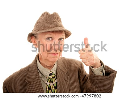 Eccentric senior woman in drag giving thumbs up gesture