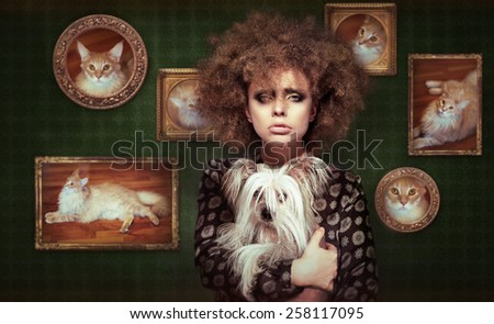 Eccentric Shaggy Woman with Pet - Little Puppy - stock photo
