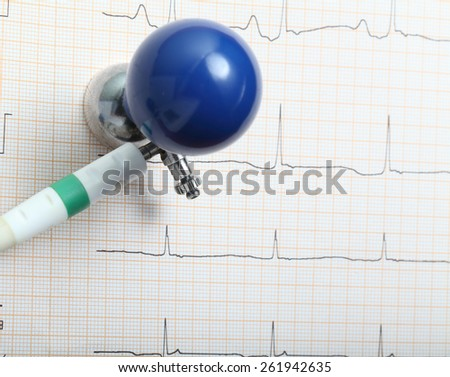 ECG electrode and chart - stock photo