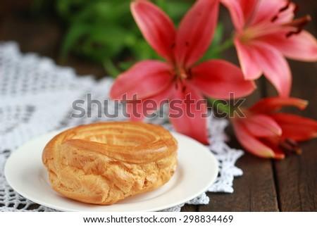 Eclairs with vanilla cream - stock photo