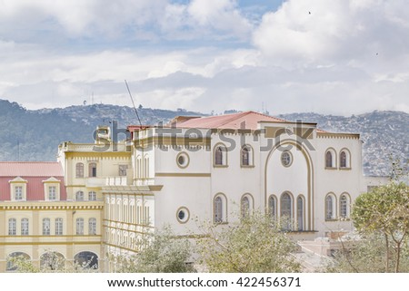 Eclectic style elegant buildings lcoated on the historic center of Quito in Ecuador - stock photo