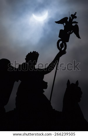 Eclipse in St. Petersburg on Palace Square and State Russian eagle - stock photo