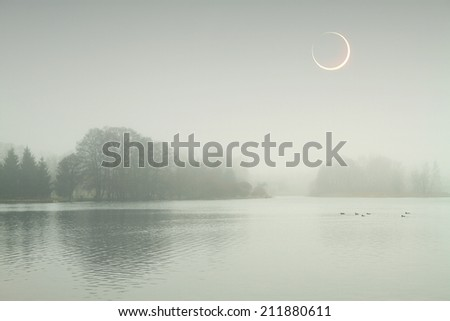 eclipse of the sun in the autumn mist. Elements of this image furnished by NASA  - stock photo