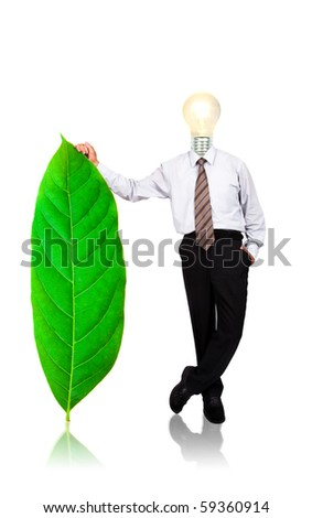 eco and green energy business concept. bulb and businessman stand with green leaf - stock photo