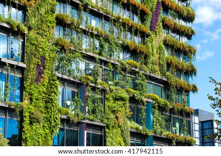 Eco architecture. Green skyscraper with hydroponic plants on the facade. Ecology and green living in city, urban environment concept. Park in the sky, One central park building, Sydney, Australia - stock photo