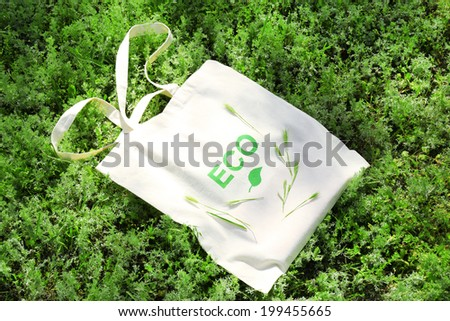 Eco bag on green grass, outdoors - stock photo