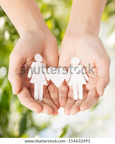 eco, bio, nature, love, harmony concept - woman hands showing two paper women with heart shape - stock photo