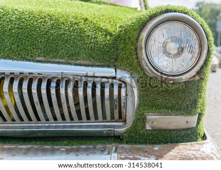 eco car covered with grass as a symbol - stock photo