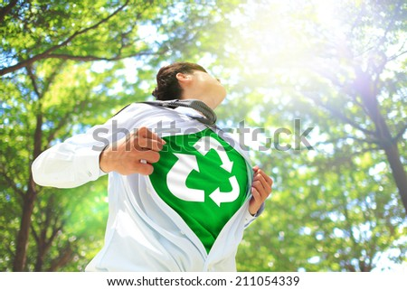 ECO concept - Business man opens his shirt to show off recycle mark in forest trees, asian - stock photo