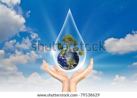 Eco concept : Hand with tree and earth in water drop - stock photo