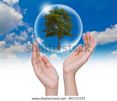Eco concept : Hand with tree in bubbles - stock photo
